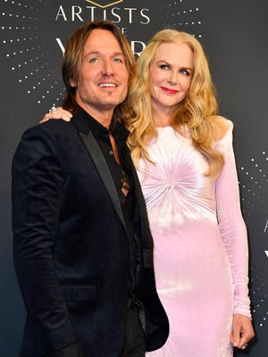 Keith Urban and Nicole Kidman walk the red carpet before the 2017 CMT Artists of the Year show Oct. 18, 2017, at the Schermerhorn Symphony Center in Nashville.
