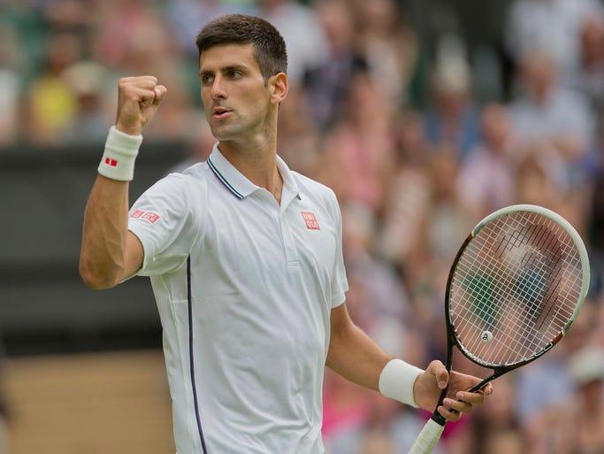 Novak Djokovic celebrates match point against Andrey Golubev.