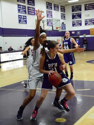 Rumson-Fair Haven's Madison Maguire (21) controls the ball under the basket during the Bulldogs' game against Saddle River in the Bulldog Classic on Sunday.