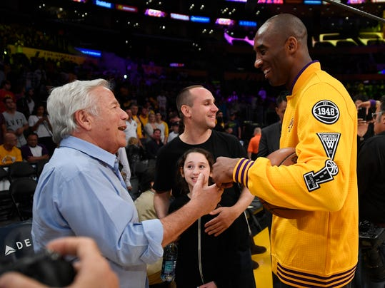 New England Patriots owner Robert Kraft, left, talks with Los Angeles Lakers forward Kobe Bryant prior to an NBA basketball game against the Denver Nuggets, Friday, March 25, 2016, in Los Angeles. (AP Photo/Mark J. Terrill)