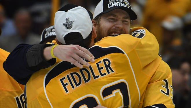 Predators center Vernon Fiddler and left wing Colin Wilson (33) celebrate after winning Game 6 of the Western Conference finals against the Anaheim Ducks on Monday, May 22, 2017.