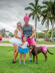 Even families - and their pets - took part in the fun for the Tri Bike Run, Tutu Two-Mile Run at Downtown at the Gardens on Aug. 26.