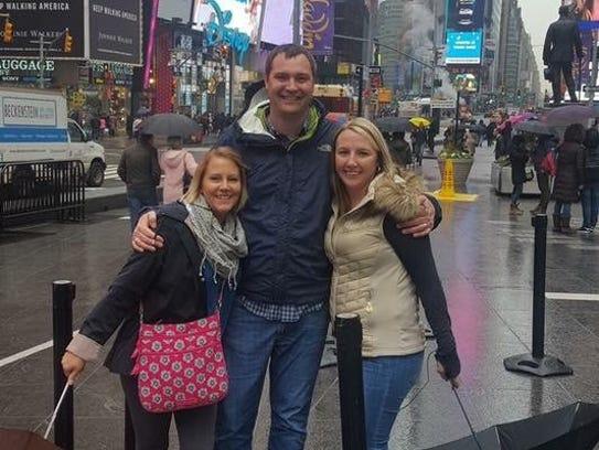 Matt White, center, with two of the women he said he