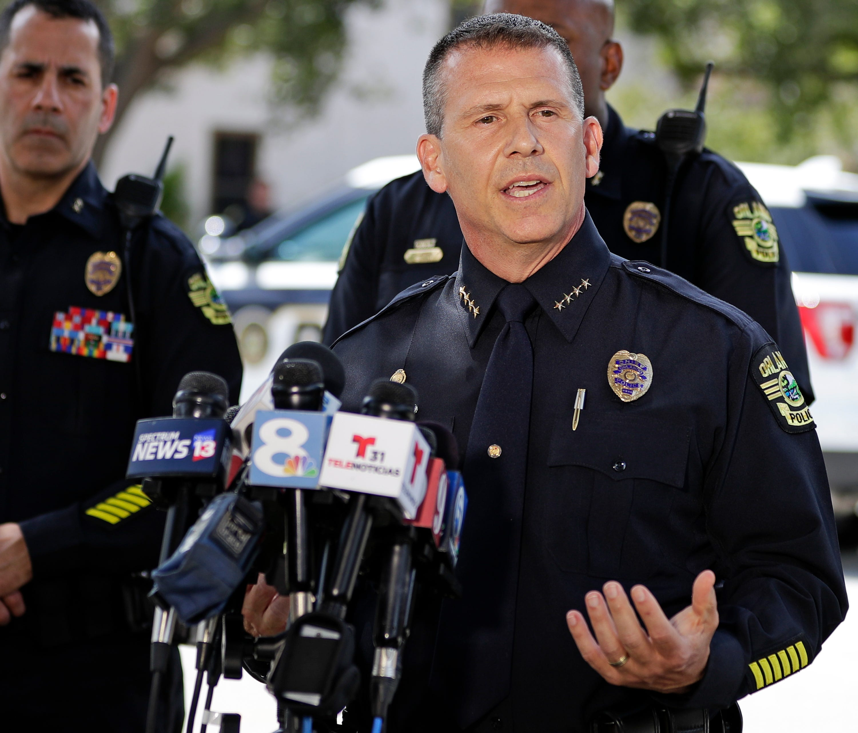 Orlando Police Chief John Mina answers questions at an afternoon news conference during a hostage standoff Monday, June 11, 2018, in Orlando, Fla. Police said a man suspected of battering his girlfriend shot a police officer late Sunday and barricade