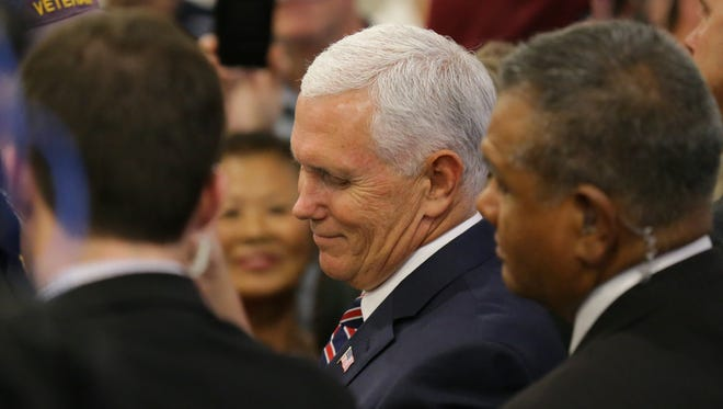 "Vice President of the United States, Mike Pence signs autographs after speaking during the ""Tax Cuts to Put America First"" town hall at the Indianapolis Downtown Marriott in Indianapolis on Friday, May 18, 2018. America's First policies organized the event."