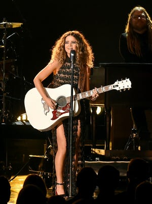 """Maren Morris performs """"My Church"""" at the 50th annual CMA Awards in Nashville. Morris scored four Grammy nominations, announced Tuesday, Dec. 6, 2016, including best new artist."""