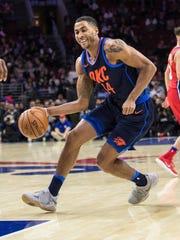 NBA player Josh Huestis speaks at the Center for Mental Health fundraiser Tuesday.