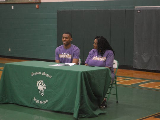 Peabody senior Dwight Simon (left) signed with LSU of Eunice and its first year basketball program.