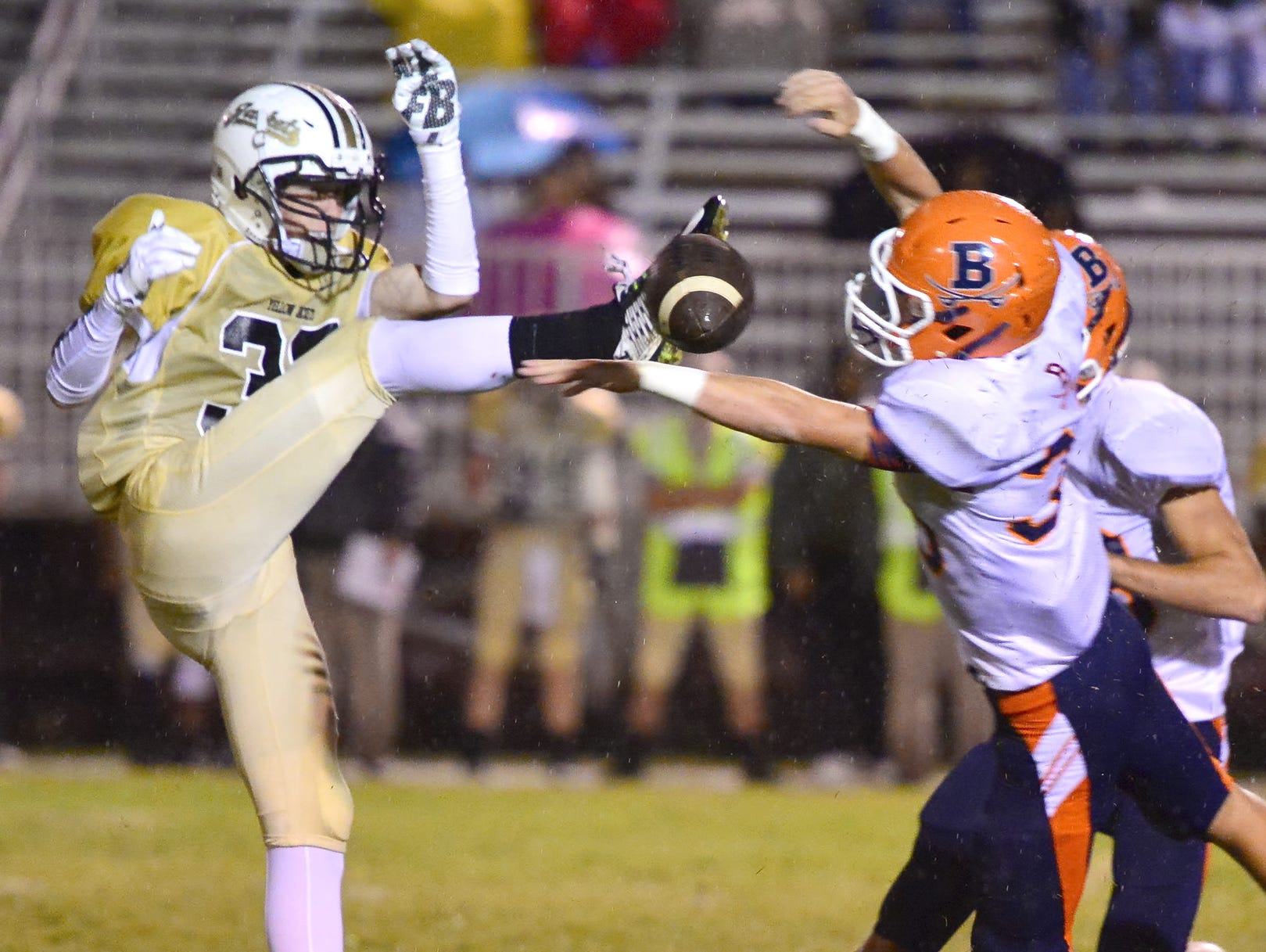 Beech defensive back, Beech's Chris Peach blocks a punt attempt by Springfield's Bryan Hayes Friday night..