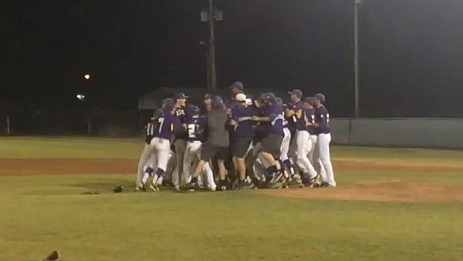 LSUS players celebrate their championship Sunday night.