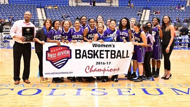 The LSUS women's basketball team celebrates its conference tournament championship.