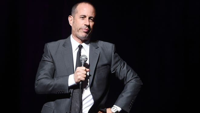 """Comedian Jerry Seinfeld performs onstage as Baby Buggy celebrates 15 years with """"An Evening with Jerry Seinfeld and Amy Schumer"""" at the  Beacon Theatre on November 16, 2015."""