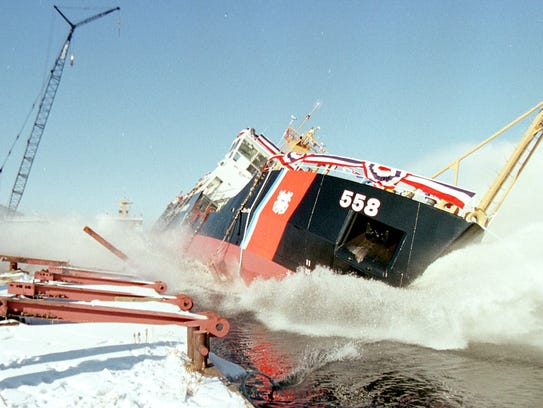 A U.S. Coast Guard cutter is launched into the Menominee