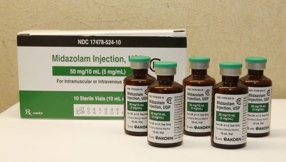 File photo shows bottles of midazolam.