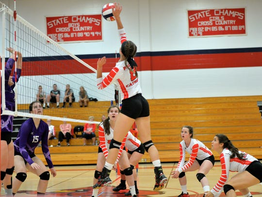The Pacelli and Pittsville volleyball teams battle in a Central Wisconsin Conference South Division matchup.
