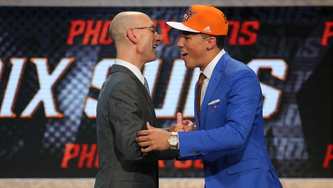 Grand Rapids native Devin Booker greets NBA commissioner Adam Silver after being selected as the No. 13 pick.