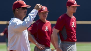 Alabama head coach Mitch Gaspard (8) gives feedback as Alabama practices for the SEC Tournament in Hoover on Monday.