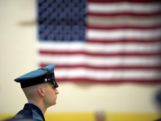 Vineland police officer Dylan Fisher walks to receive