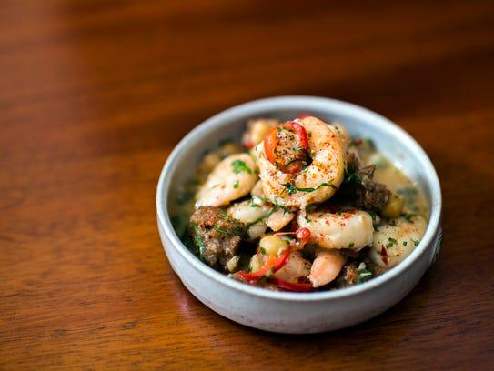 A Gambas al ajillo dish featuring shrimp, chili, lemon