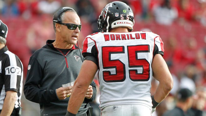 Atlanta Falcons defensive coordinator Mike Nolan talks with inside linebacker Paul Worrilow (55) during a game with the Tampa Bay Buccaneers at Raymond James Stadium in Tampa, Fla., on Nov. 9.