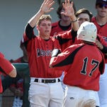 Wooster's Robert Gordon high fives a teammate during a recent game against Bishop Manogue on April 19.