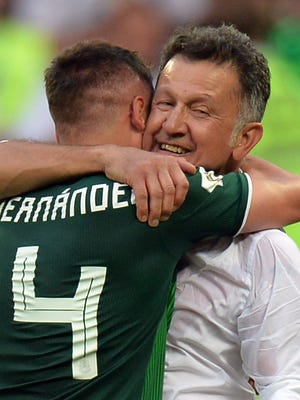 Mexico coach Juan Carlos Osorio and forward Javier Hernandez celebrate after beating Germany.