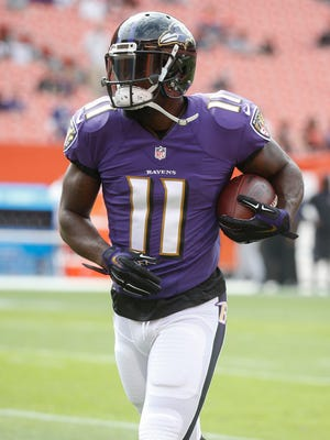 Baltimore Ravens wide receiver Kamar Aiken practices before an NFL football game against the Cleveland Browns, Sunday, Sept. 18, 2016, in Cleveland. (AP Photo/Ron Schwane)