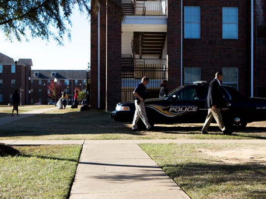 Grambling State University Police return to their vehicle after visiting the scene of the shooting deaths of senior criminal justice major Earl Andrews and his friend Monquiarious Caldwell, who was visiting from their hometown of Farmerville, in Grambling , La., Wednesday, Oct. 25, 2017. Andrews and Caldwell were shot in the courtyard between J.D.E. Bowen and Phyllis Wheatley, two dormitories on campus. The suspect is at large.