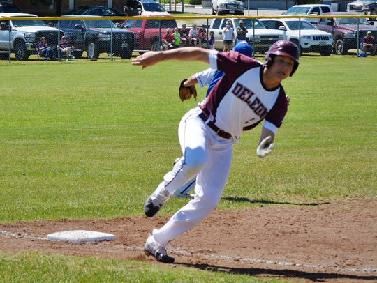 De Leon's Cooper Dyson rounds third base in Game 2