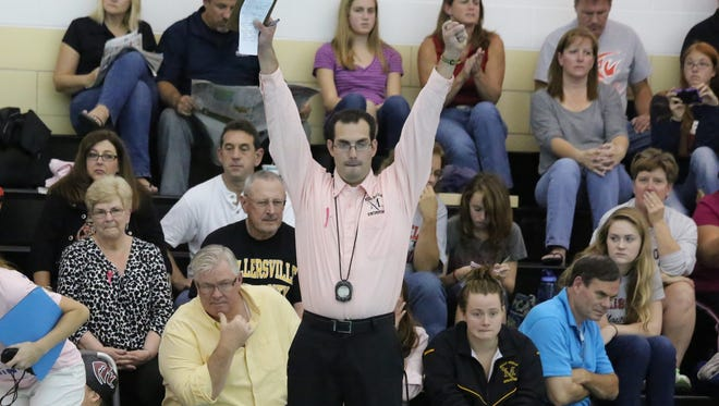 Northeastern High School graduate Kyle Almoney is shown here during his days leading the Millersville University women's swimming program.