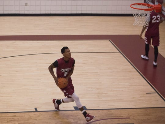 New Mexico State senior Jemerrio Jones goes for a lay up during NMSU summer workouts on Wednesday at the Pan American Center.
