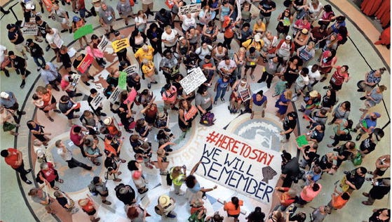 "Protesters gather in the Texas Capitol Rotunda as State lawmakers begin a special legislative session called by Republican Gov. Greg Abbott in Austin, Texas, Tuesday, July 18, 2017. Immigrant rights groups plan to increase protests of the new law that allows police to inquire about peoples' immigration status, while LGBT activists bitterly oppose ""bathroom bill"" proposals."