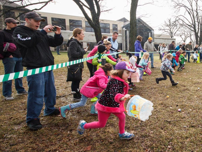 Youngsters race to collect candy filled eggs during