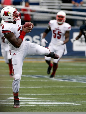 Sep 20, 2014; Miami, FL, USA;  Louisville Cardinals safety Gerod Holliman (8) intercepts a pass in the second quarter of a game against the FIU Golden Panthers in the second quarter at FIU Stadium. Mandatory Credit: Robert Mayer-USA TODAY Sports