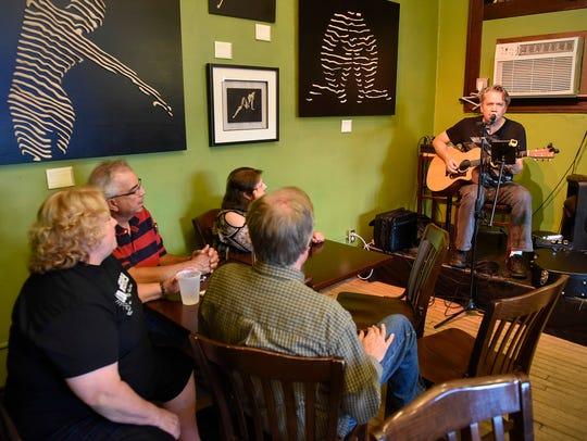 Leon Laudenbach plays guitar and sings Thursday Aug.