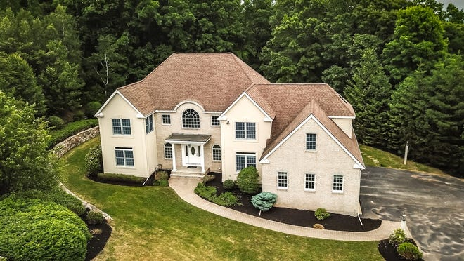This 6,086-square-foot house at 11 Arrowhead Lane in Westboro lists for $1.25 million.