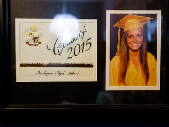 Samantha Huntley's graduation photo hangs on a wall