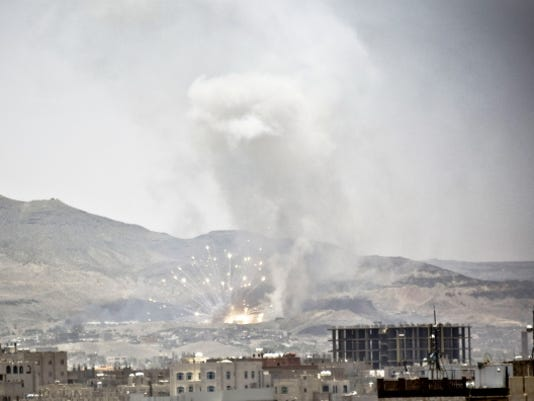 Smoke rises after a Saudi-led airstrike hit a site where many believe the largest weapons cache in Yemen's capital, Sanaa, on Tuesday, April 21, 2015. The Saudi-led coalition pounded Shiite rebels in Yemen on Tuesday, killing at least 19 in a city in the country's west, officials said.