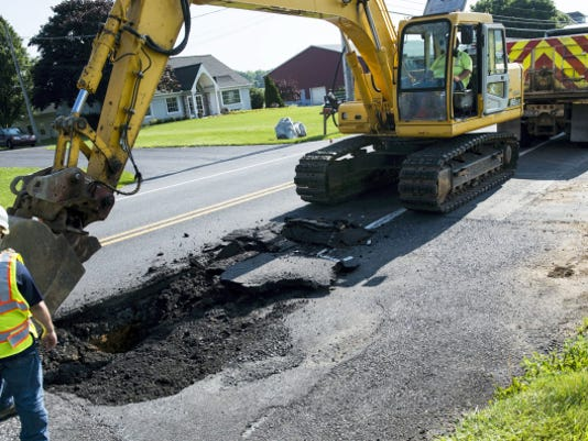 A sinkhole on Rt 322 in South Annville Township appeared Monday morning and forced one lane to be closed as crews from PennDOT worked to repair it on Monday, June 22, 2015. Jeremy Long -- Lebanon Daily News
