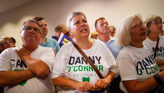 Supporters of Danny O'Connor, the Franklin County recorder, anxiously watch results during an election night watch party at the Ohio Civil Service Employees Association, Tuesday, Aug. 7, 2018, in Westerville, Ohio. O'Connor ran against Republican Troy Balderson in a special election race for Ohio's 12th District after the retirement of Pat Tiberi who served as the U.S. Representative from 2001-2018 in the reliably Republican district.