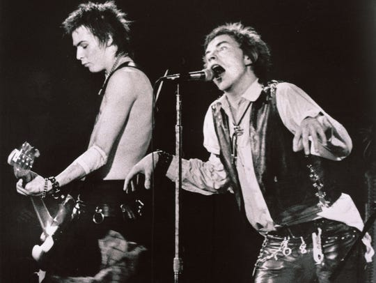 Sid Vicious, left, and Johnny Rotten of the Sex Pistols perform in front of a capacity crowd at San Fracisco, Calif.'s Winterland auditorium in this Jan. 15, 1978 file photo.