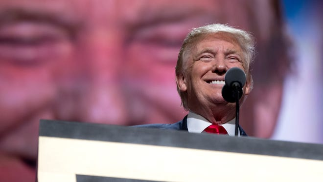 Republican Presidential Candidate Donald Trump pauses to smile as he speaks during the final day of the Republican National Convention in Cleveland on July 21, 2016.