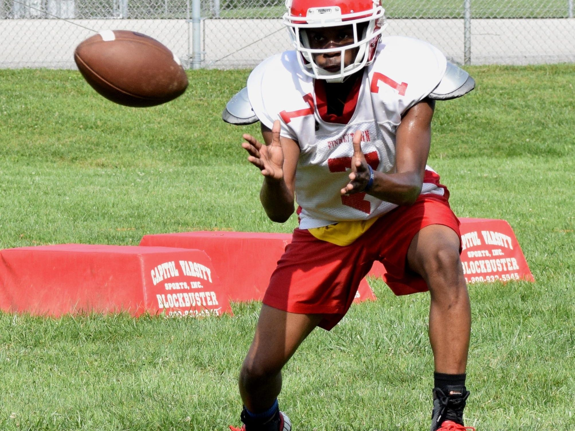 Finneytown wide receiver Delson Watson looks in a pass during Wildcat practice.