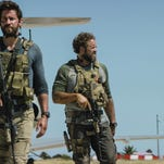 """From left, Pablo Schreiber, John Krasinski and David Denman in a scene from """"13 Hours: The Secret Soldiers of Benghazi."""""""