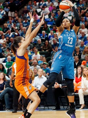 Minnesota Lynx's Maya Moore (23) shoots as Phoenix Mercury's Nirra Fields defends in the first quarter of a WNBA playoff semi-finals basketball game Wednesday, Sept. 28, 2016, in St. Paul, Minn.