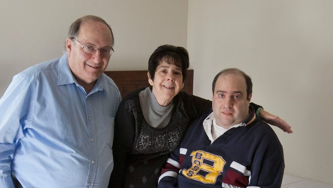 Adam Resnick (right), an autistic man who has just moved out of his parents home into an apartment in Barnegat. He is with his parents Edward and Ilene Resnick of Cherry Hill in his new bedroom—November 23, 2015-Barnegat, NJ.-Staff photographer/Bob Bielk/Asbury Park Press