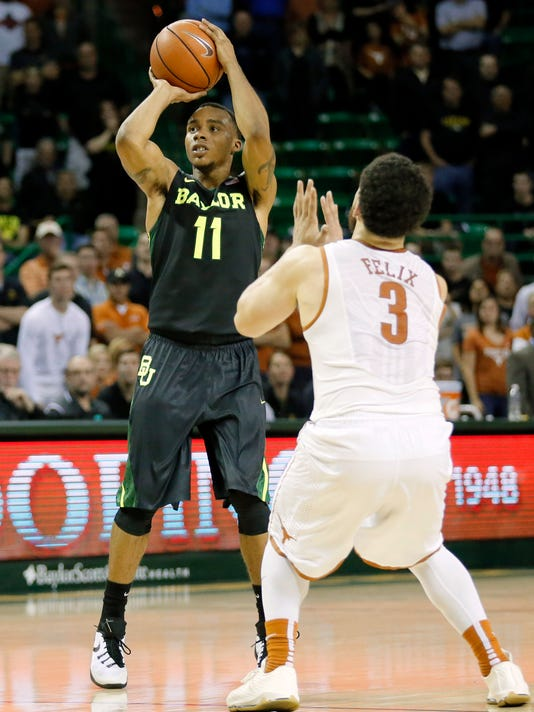 Baylor guard Lester Medford (11) attempts a 3-point basket as Texas's Javan Felix (3) defends in the second half of an NCAA college basketball game, Monday, Feb. 1, 2016, in Waco, Texas. Texas won 67-59. (AP Photo/Tony Gutierrez)
