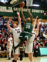 St. Johnsbury's Rain Hayman-Jones (30) leaps for a