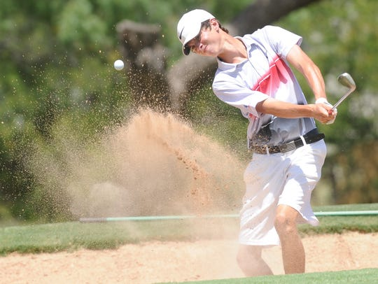 Heath's Matthew Watkins hits out of the bunker and