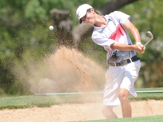 Heath's Matthew Watkins hits out of the bunker and onto the green at 15 during the final round of the AJGA Folds of Honor Junior Championship hosted by Bob Estes on Thursday, July 19, 2018 at the Abilene Country Club's Club Course. Watkins shot a final-round 68 to finish third with a 203 -- two shots behind the winner.